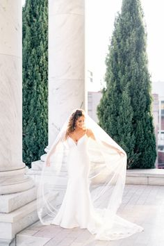 This minimalist wedding dress with a plunging neckline has a classic trumpet silhouette. The modern wedding dress has a low back with sparkle straps. #customweddingdress #designerweddingdress #sexyweddingdress #modernweddingdress #minimalistweddingdresses #bride #wedding #bridalgown #weddingdress