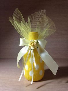 botellas decoradas con globos amarillo