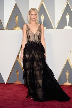 Jennifer Lawrence may have arrived late to the Oscars, but she did so fashionably and nakedly in this lacy, see-through, and plume-adorned Dior Couture gown.
