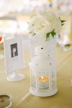 White lanterns & buckets with white roses
