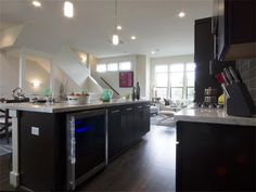 Contemporary Kitchen with Subway Tile, One-wall, High ceiling, Breakfast bar, Kitchen island, Flush, Pendant Light