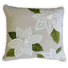 """BLESSING CUSHION  $29.99  Blessing features appliquéd and embroidered white poinsettias with white pom pom centers and green foliage on a linen background.  Bordered with white pom poms around the entire perimeter.  18x18""""."""