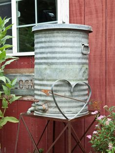 Country Sampler | Home Tours 2013 - cute rain barrel!
