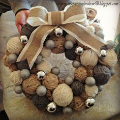Christmas ball ornaments wrapped in yarn, added onto a burlap wreath
