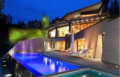 This completely hidden and gated 9,455-sq-ft modern home on West Vancouver's waterfront features five bedrooms, 6.5 bathrooms, infinty-style swimming pool, built-in BBQ kitchen, four-car garage and a private path to the beach. Want the address? You'll have to put in a special request with the realtor.