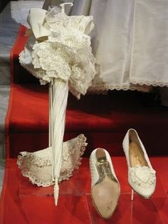 Diana's Parasol  (in case it rained on her wedding day). purse and shoes.