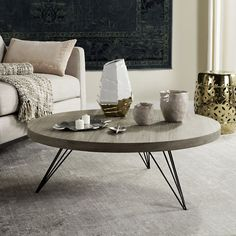 Inspired by modern rustic style, the Safavieh Mansel Coffee Round Table is the perfect complement to your contemporary décor. The unique table features a metallic angular base paired with a warm circular light grey top for timeless sophistication. Coffee Table Frame, Black Coffee Tables, Round Coffee Table, Coffee Table With Storage, Modern Coffee Tables, Circular Coffee Table, Mid Century Coffee Table, Round Tables, Grey Wood Furniture