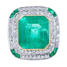 7.44 Carat Colombian Emerald Gold Platinum Cocktail Ring   From a unique collection of vintage cocktail rings at https://www.1stdibs.com/jewelry/rings/cocktail-rings/