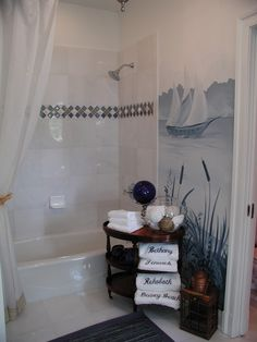 Inspiring Blue and White Bathroom Accessories: Glass Tile And Real Shell Border In The Shower Wall Is The Finishing Touch To This Blue And White Bathroom ~ gtrinity.com Bathroom Design Inspiration