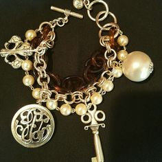 """NEW w/o Tags John Wind Limited Edition Bracelet NEW without Tags, John Wind Limited Edition Bracelet with  strands of SILVER, PEARLS, and TORTOISE! This bracelet also has three (4) LARGE CHARMS,  a FLEUR-DE-LIS, PEARL, KEY, and the """"JOHN WIND UNIVERSAL EMBLEM"""" with Tortoise back. This bracelet is exquisite and is a great accessory to any outfit!  *John Wind jewelry is a leader of fine costume jewelry. John Wind  Jewelry Bracelets"""
