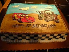 Cars birthday cake.  1/2 sheet frosted in buttercream.  I drew the image out of icing gels and the checker flag on side is modeling chocolate.