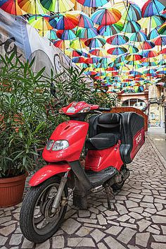 Motorbike On Piata Odeon - Bucharest, Romania Print by Barry O Carroll