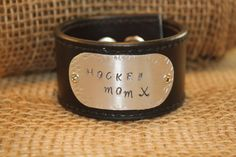 Hockey Mom Handmade Leather Cuff made with an up-cycled leather belt.