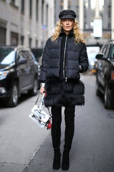 Fur trim and a camo print Proenza Schouler bag make this a covetable mix - Street Style at New York Fashion Week #NYFW
