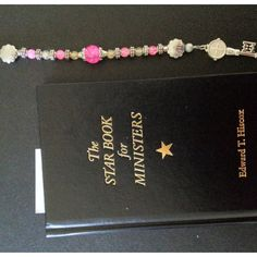 My ministers book and St Benedict charm I made and blessed for my unborn niece Sophia.