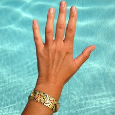 Super Hockney right now with the Memphis bracelet. #davidhockney #memphisgroup #pool