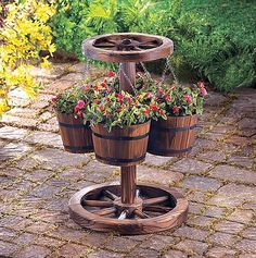 Wooden and metal country planter generates an instant sanctuary with a little country charm! Four buckets hold a quartet of your loveliest plants. Planters suspended from a realistic wagon wheel cente