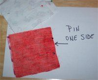 Pin and sew one side of two squares pretty sides together for your quilt.