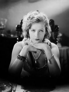 """""""She was never Greta; she was always Garbo. And she must be seen — projected, larger-than-life, on the big screen — to be believed. Garbo is one of the remaining enigmas of Hollywood history: did she love men? Women? Both? Did she turn her back on Hollywood? Did she truly 'want to be alone'? Was she a figment of Hollywood's imagination, the product of light and mirrors, or a woman in control of her own destiny?"""" Scandals of Classic Hollywood: The Exquisite Garbo"""