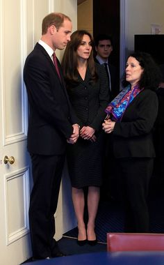 Prince William, Duke of Cambridge and Catherine, Duchess of Cambridge speak to French Ambassador to London Sylvie Bermann before signing the book of condolences after the terror attacks which killed at least 129 people in Paris, at the French Embassy on November 17, 2015 London, England.
