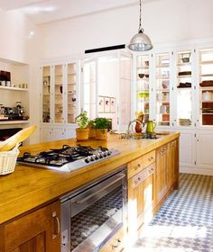 love all the double faced open cabinetry, lets so much light into the kitchen as well as illuminating the accessories in the cabinets