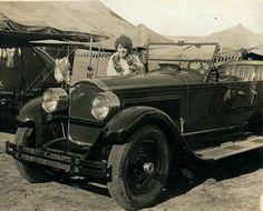 Undated photograph of Lillian Lietzel standing behind a Packard automobile.  (Circus Museum)