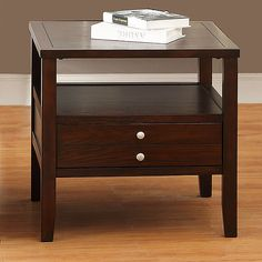 This Ingleby end table features espresso wood top with simple and graceful style. This contemporary table has a handsome simplicity that will be sure to enhance any room decor.