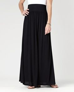 Stylist, I have a black maxi skirt. I need tops to go with it. Thank you for your help!