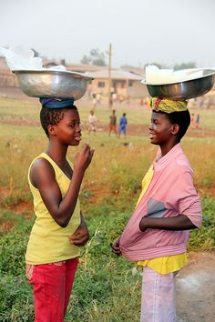 Two young women chatting together in the market in Techiman, Ghana