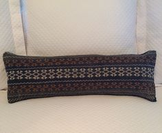 handmade rug pillow- front navy, orange, grey & cream rug pattern. back- navy velvet. 10 inches x 26 inches