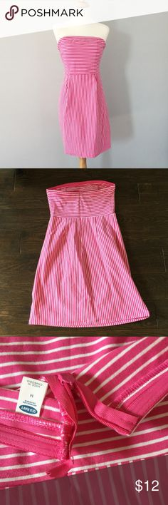 NWOT Strapless Ponte Knit Old Navy Dress Hot Pink and White striped Ponte knot dress from Old Navy. Ponte Knit fabric makes this dress perfect for spring + summer. Does not wrinkle easily (yay!) and can be dressed up or down. Dress has a rubberized band around the bust (to help stop the usual Strapless dress slide)! I never got to wear this cute dress, but the strings on the top of the zipper have come undone. Shouldn't cause any problems and would be an easy fix. Old Navy Dresses Strapless