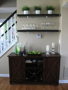 Mini-bar idea in kitchen with open shelving maybe on wall by staircase?