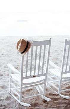 I love this picture.  My papa had a hat just like this and lived on the beach.  We walked it and sat on it many a time while he wore his hat.  Aah.  Precious memories now.  :)