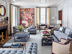 A majestic Cecily Brown painting and a small work by Damien Hirst animate the graceful living room of a couple's New York City apartment, which was renovated by S. R. Gambrel in collaboration with the architecture firm Arcologica.