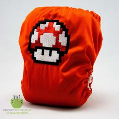 Mario Bros. Red Mushroom Inspired - One-size (OS) Pocket Cloth Diaper and Microfiber Insert. $24.95, via Etsy.
