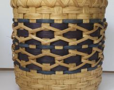 Round woven basket with wooden bottom.