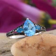 Embrace the captivating charm of this electric blue topaz ring and become a center of attraction on all occasions. Embellished with Thai black spinel and Malgache neon apatite and fashioned in nickel free sterling silver with platinum overlay, this alluring beauty is designed to win everyone's heart. Free Shipping Gift Box