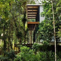 I love this house with the balconies surrounded by trees