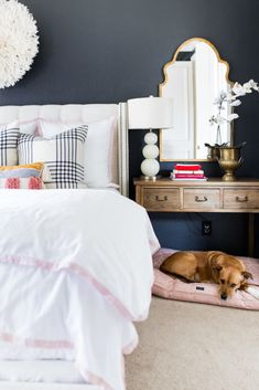 Evenings with the pup are best spent with modern glam master bedroom details a la motif mirroring and pop print throws Glam Master Bedroom, Pretty Bedroom, Cozy Bedroom, Home Decor Bedroom, Bedroom Ideas, Master Bedrooms, Teen Bedroom, Dream Bedroom, Bedroom Wall