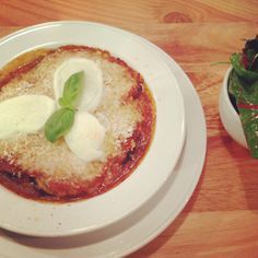 Melenzane alla parmigiana  Aubergine layered with tomato sauce, pesto and Parmesan, topped with mozzarella and baked in the oven.