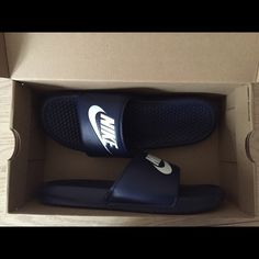 Nike Sliders size 9 in women's. Navy blue. Worn once or twice. Included with original packaging. Nike Shoes Athletic Shoes
