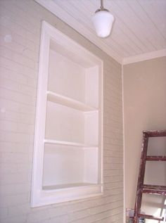 Neat O. Recessed Shelving Set Into A Wall. All White And Plain Becomes