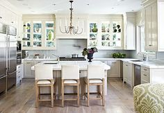 great idea! ~windows forming the back walls of glass-door cabinets.