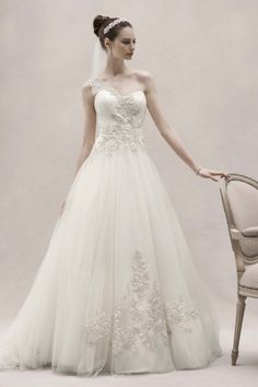 Use of applique.  whitedream:  I have posted this dress before and it's probably my second favorite or third maybe. It is so gorgeous.  By Oleg Cassini  Follow my tumblr for more beautiful wedding dresses (: