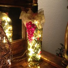 Christmas lights in a wine bottle brightens up your house