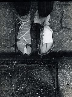 Hundertwasser wearing his handmade winter and summer shoes.