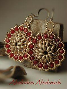 Calendulas confeccionadas con twin beads, cristales swarovski y seed beads 24 kt gold