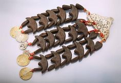 Temple jewellery with wood and corals , Tunisia approx. 1900s, silver, 3-row, coral lenses, wooden elements, hand of Fatima, Hilalpendant gilded, very rare, l. approx. 32 cm . German Description: Schläfenschmuck mit Holz und Korallen, Tunesien um 1900, Silber, 3-reihig halbmondförmige Schmuckglieder aus Holz, Korallenlinsen, Hand der Fatima, Hilal Anhänger verg., geprägte Blech- scheiben, sehr selten, L. ca. 32 cm