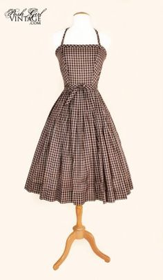 I want to pair every vintage day dress I see with a long cardigan, tights, boots and then go stomping around the bogs.