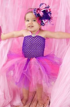 A playful mix of hues is what makes this purple and hot pink tutu dress so endearing. Designed in fine artisan detail, it features a purple crocheted halter top with satin . Baby Tutu Dresses, Pink Tutu Dress, Purple Tutu, Pink Tulle, Baby Dress, Girls Dresses, Flower Girl Dresses, Baby Skirt, Purple Baby